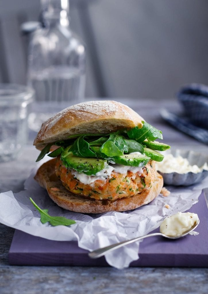 Salmon Avocado Burgers served with rocket and mayonnaise. Shot for Good Housekeeping showing meals that can be made and then frozen for later.