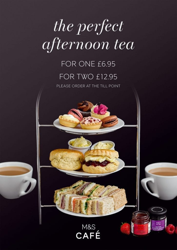 Afternoon Tea with cakes, macaroons, scones and sandwiches served with tea
