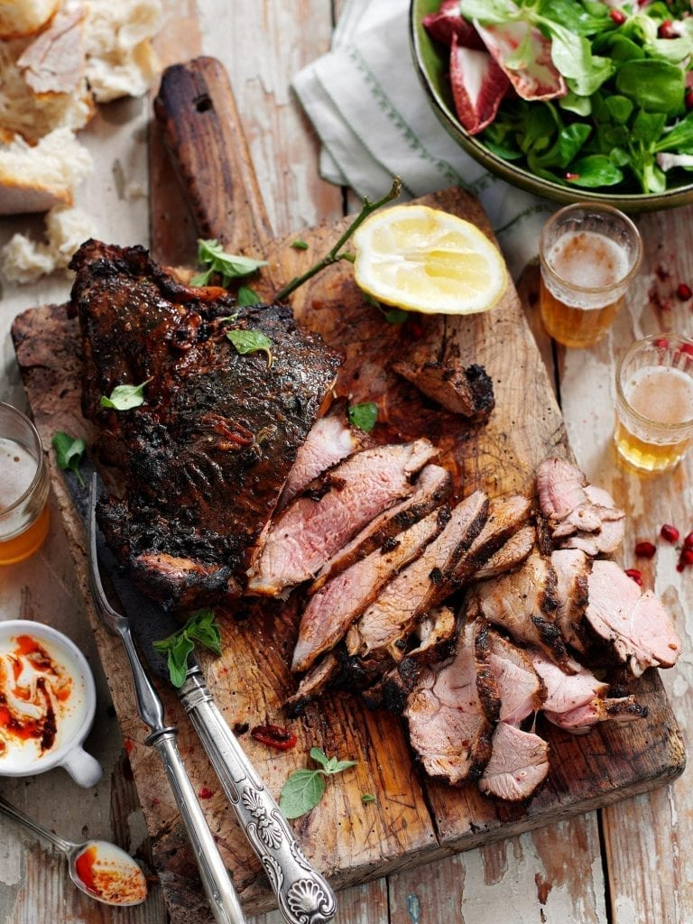 Butterfly Lamb sliced and served with a salad bread and beer. Shot for Jamie Magazine