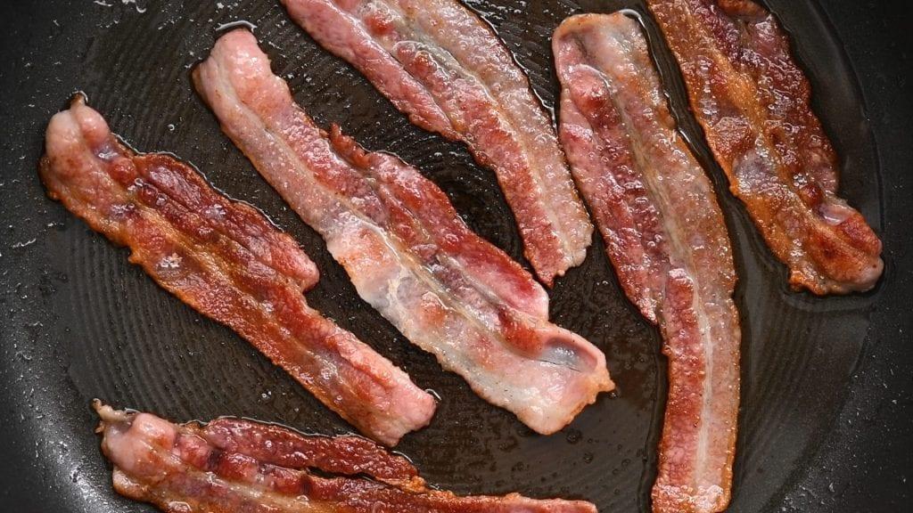 Frying bacon in a pan