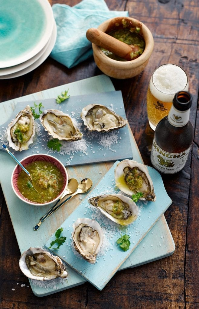 Oysters served with nam jim sauce and Singha Beer.