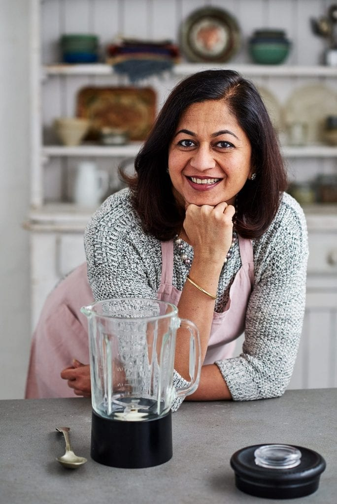 Portrait of chef Monisha Bharadwaj in the kitchen for the book Indian Cook Course for Kyle Books.