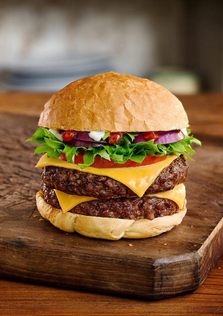 Personal work of a cheeseburger with lettuce onion and tomato